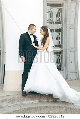 Newly Married Couple Hugging On Old Stairway