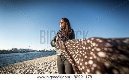 Brunette Woman In Scarf Posing On Beach At Windy Day