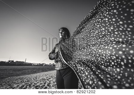 Black And White Portrait Of Woman In Scarf At Windy Day On Beach