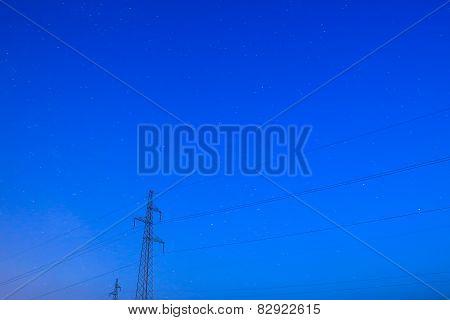 Pylons Under Starry Sky
