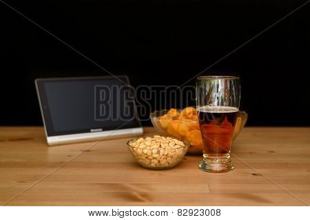 Standing Tablet With Unhealthy Snack Isolated On Black Background