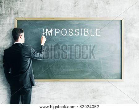 Businessman Drawing Impossible