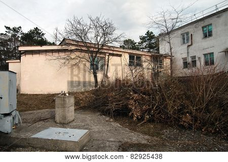 Courtyard Near The Old Soviet Buildings In Late Autumn