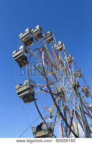 Coquitlam BC Canada - April 13 2014 : Ferris wheel against blue sky in Coquitlam playland, BC Canada.