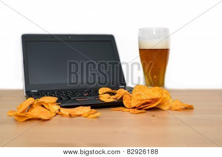 Open Laptop With Chips Scattered On Keyboard Isolated On White Background