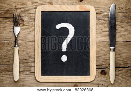 Fork And Knife And Question Mark On Blackboard