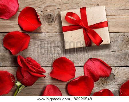 Gift Box And Red Rose On Wooden Background
