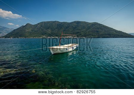 Kotor Bay With Moored White Wooden Rowboat