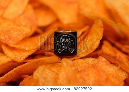 Closeup Of Dice With Skull Sketch Lying On Pile Of Chips