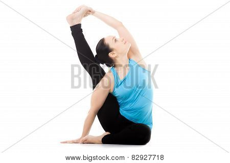 Yogi Female In Yoga Asana Parivritta Surya Yantrasana, Compass Pose