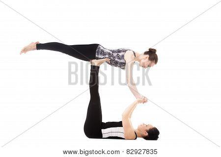 Two Yogi Female Partners Doing Yoga Exercises
