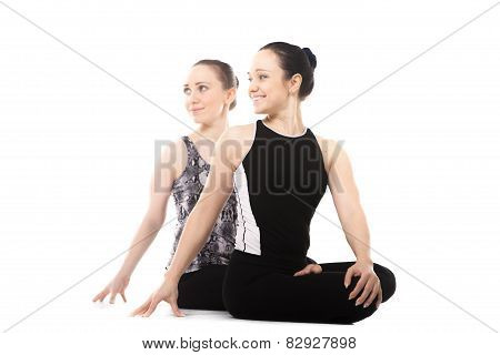 Two Yogi Female Partners Relaxing In Yoga Lotus Pose
