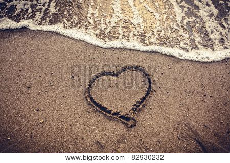 Toned Photo Of Heart Drawn On Sand Sea Beach