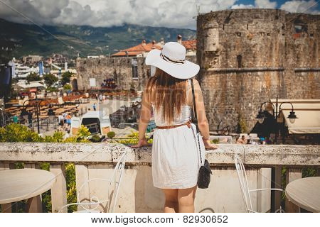 Photo Of Beautiful Woman Wearing Hat Looking At Old City