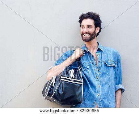 Happy Man Holding Travel Bag Over Shoulder