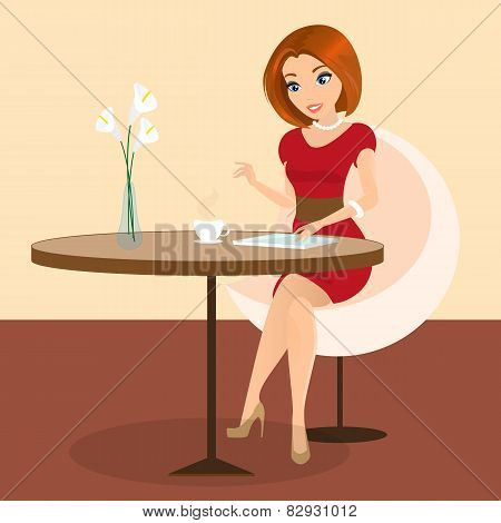 Young pretty woman sitting alone in the cafe and using a tablet pc