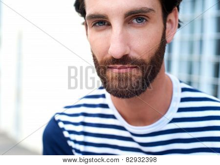 Handsome Young Man With Beard Staring