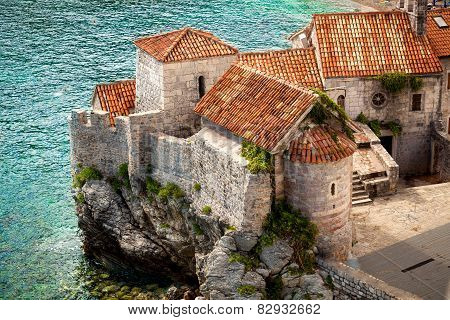 Ancient City With Red Roofs Standing On High Cliff At Seaside
