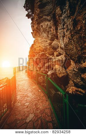 Path With Handrails In High Mountains At Sunset
