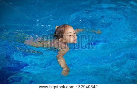 Girl Trying To Hold On Water Surface At Swimming Pool