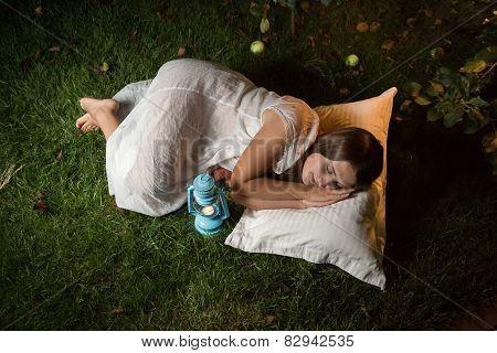 Cute Woman Sleeping In Garden At Night