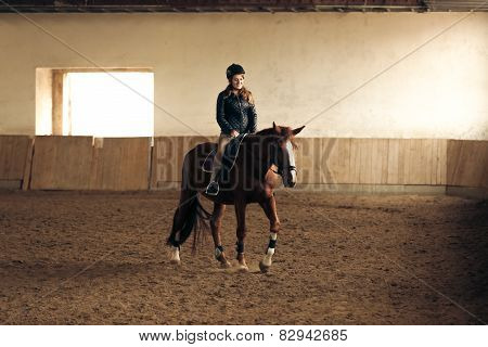 Woman Training Brown Horse In Riding Hall