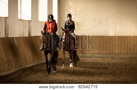 Two Woman Jockeys Doing Training In Riding Hall