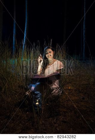 Photo Of Smiling Woman Holding Book At Beautiful Night Forest