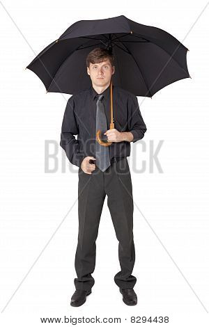 Serious Man In Black Clothes With An Umbrella