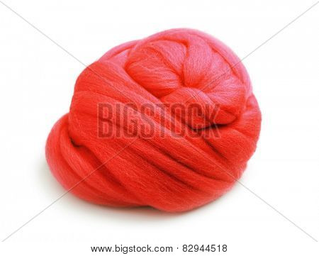 Skein of red yarn staple fiber isolated on white