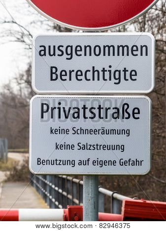 sign of a private road with driving ban for non-entitled. parents are responsible for the children.