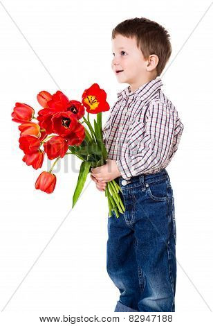 boy gives a bouquet of tulips