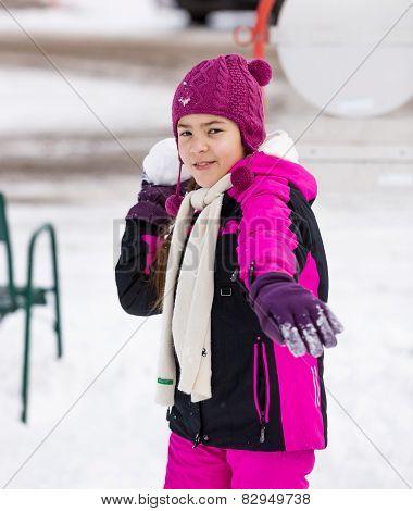 Cute Girl Throwing Snowball At Camera