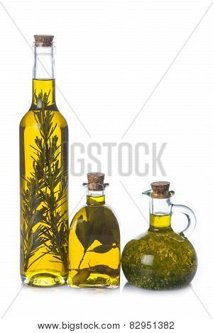 Olive Oil Bottles With Aromatic Herbs