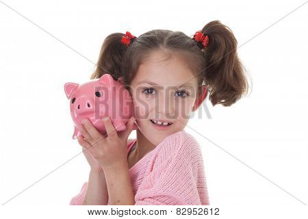 child with savings in piggy bank money box