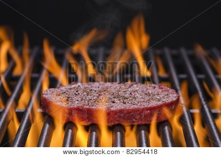 Hamburger Patty on a Hot Flaming Grill
