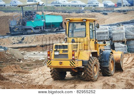 wheel loader excavator at construction earthmoving works