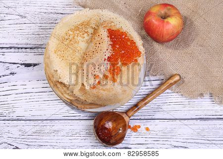 Pancakes With Red Caviar And A Red Apple