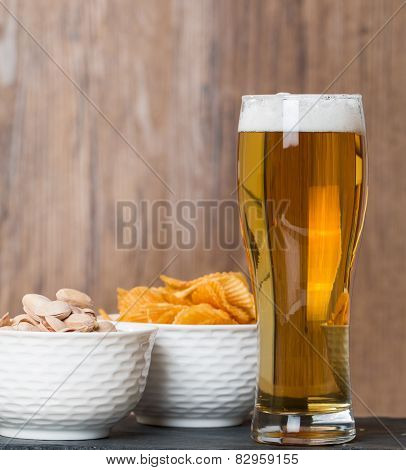 Glass Of Beer, Golden Chips And  Pistachios In Bowl