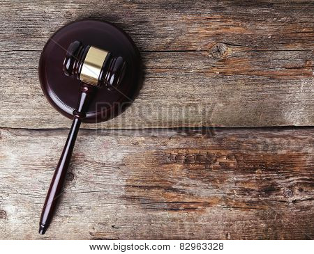 Judge hammer on the wooden table