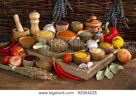 Pices And Herbs In Wooden Bowl On Wooden Table