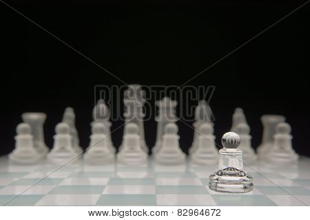 One pawn against many enemies. Shallow depth of field