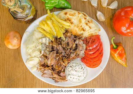 Plate of traditional Greek gyros with meat