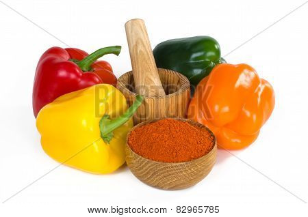 Bell Pepper And Paprika Powder In A Wooden Bowl On White Background