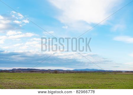 Blue Sky Over Winter Agricultural Fields In Spring