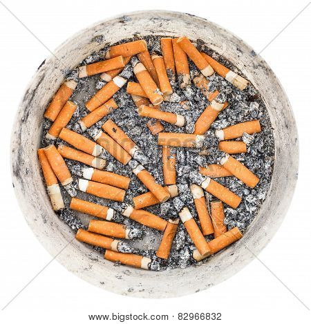 Many Cigarette Ends In Plastic Ashtray Isolated