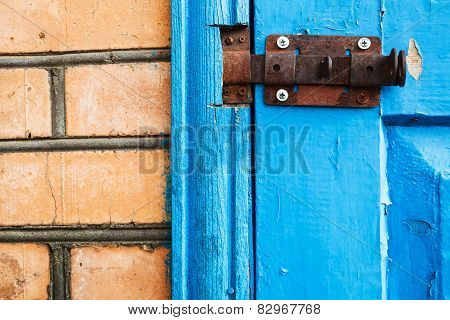 Closed Metal Latch On Blue Painted Woooden Door