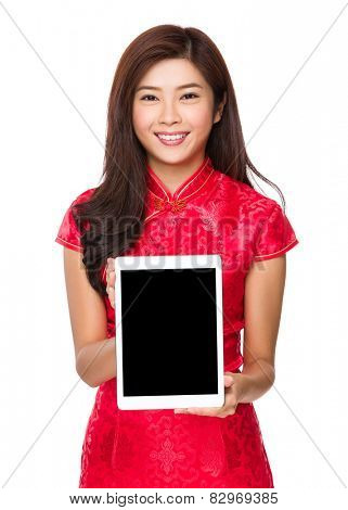 Chinese woman with cheongsam show with tablet