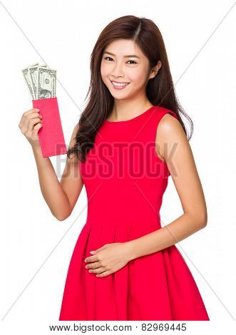 Woman hold red pocket with USD