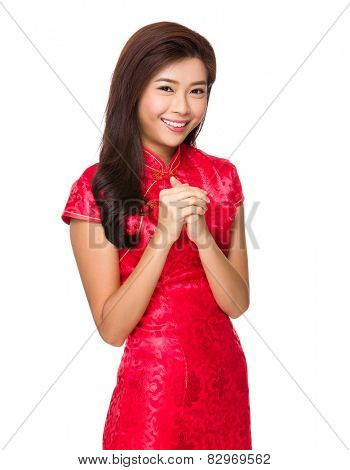 Chinese woman with congratulation sign for lunar new year